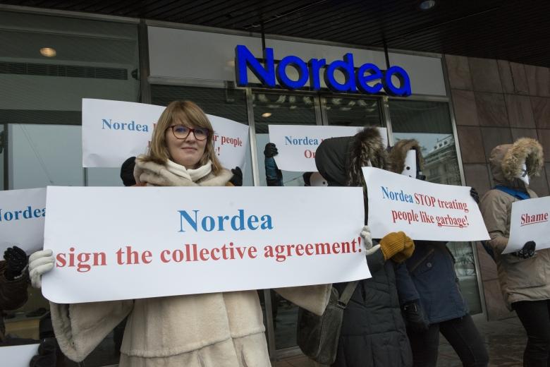 Rädda Nordea-anställda protesterade maskerade
